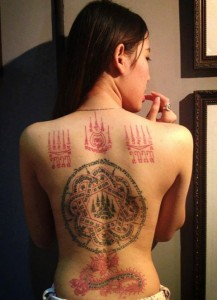 girl with talisman tattoos